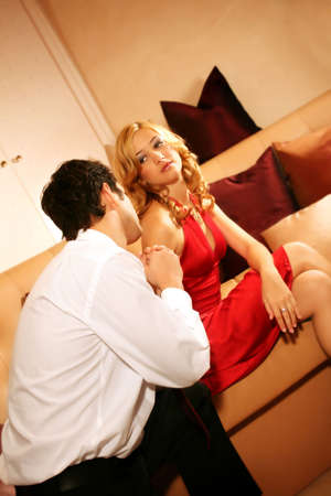 young and rich couple is sitting on a lounge and have an argue photo