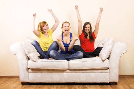 Three young beautiful women are cheering on a lounge Stock Photo - 5018247