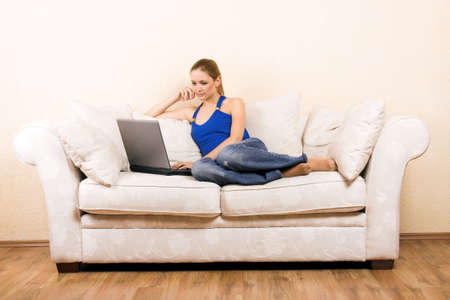 a young beautiful woman with a laptop on a lounge Stock Photo - 5018172