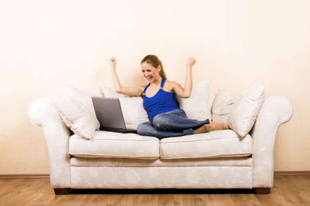 a young successful beautiful woman with a laptop on a lounge Stock Photo