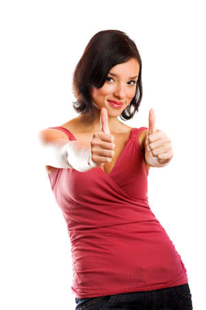 A young successful and happy woman is smiling with thumbs up isolated on white background