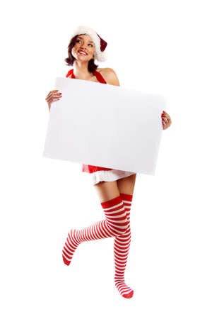 smiling christmas woman isolated on white background with a white paper Stock Photo - 5018066