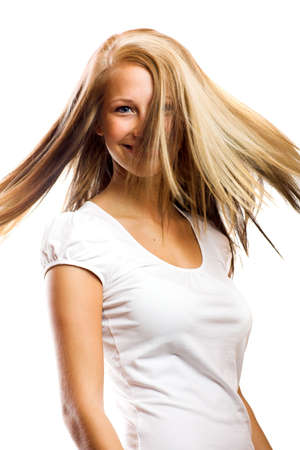 beauty portrait of a woman without make up and flying hair photo