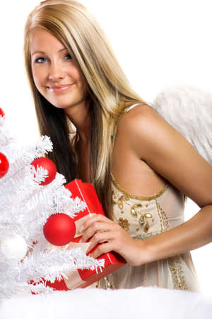 smiling christmas angel on white background with a christmas-tree and a gift Stock Photo - 5017893