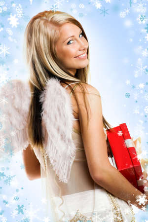smiling christmas angel on white background with wings and a gift