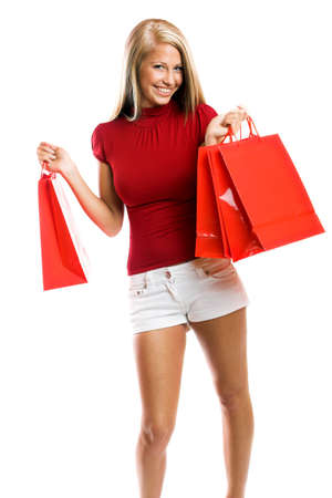 young smiling woman with shopping bags isolated on white background photo