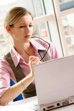 a successful business woman is working on a table with a laptop Stock Photo - 5064710