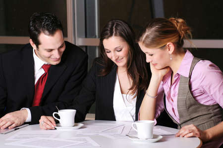 a successful business team with a document on a table