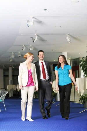 successful business team is walking and talking in a foyer Stock Photo - 5051783