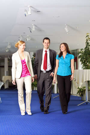 successful business team is walking and talking in a foyer Stock Photo - 5051819