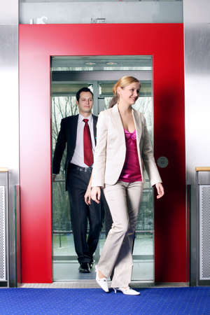 successful business team in lift is talking