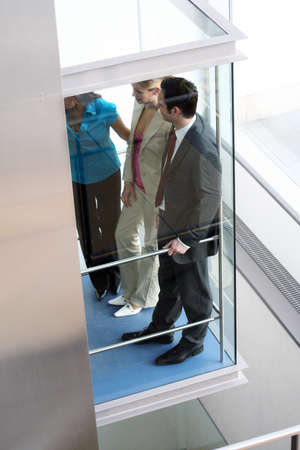 elevator: successful business team in lift is talking
