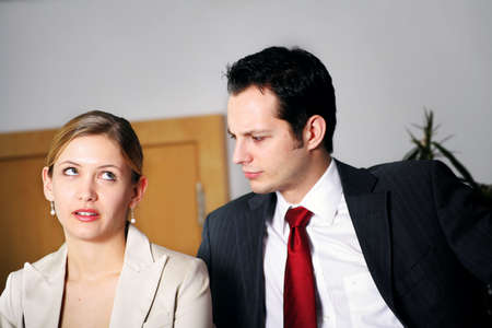 unfriendly: a businesswoman is stressed by her colleague Stock Photo