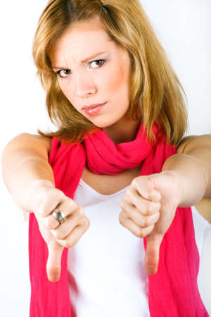 unfriendly: Portrait of a young angry woman with thumbs down
