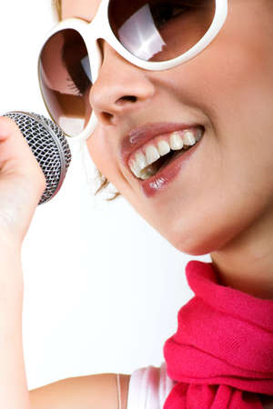 portrait of a happy singing woman with a microphone photo