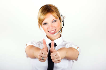 successful and happy business woman is calling with a headset Stock Photo