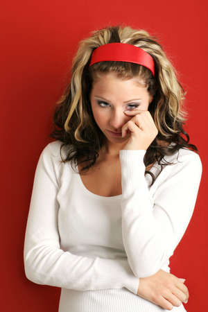A young, attractive and unhappy woman is crying Stock Photo - 5085534