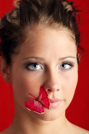 beauty portrait of a beautiful young woman with a butterfly on her mouth Stock Photo - 5085499