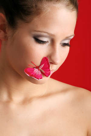 beauty portrait of a beautiful young woman with a butterfly on her mouth Stock Photo - 5085532