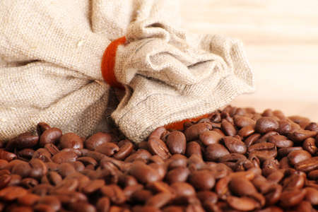 some coffee beans and a jute sack photo