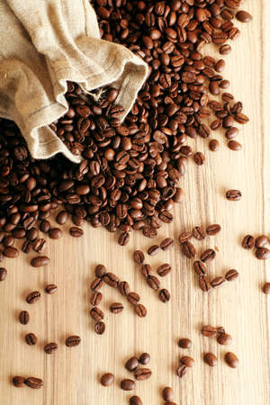some coffee beans and a jute sack with the word cafe Stock Photo - 5085556