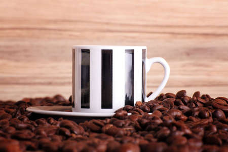 some coffee beans and a cup of black and tasty coffee Stock Photo - 5085549