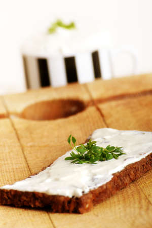 herbage: a whole-grain bread with some herbage and a cream cheese Stock Photo