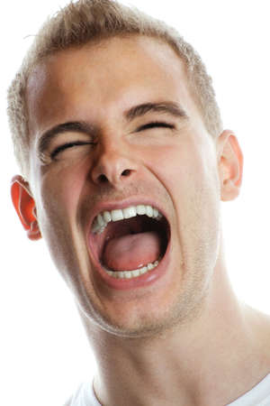 unsatisfied: portrait of a young strong and screaming man isolated on white background Stock Photo