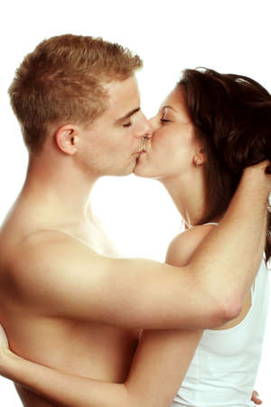 a young sexy couple is kissing isolated on white background Stock Photo - 5075764