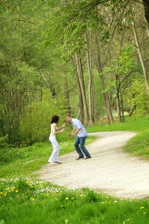 a young happy and smiling couple is playing tag Stock Photo - 5075996