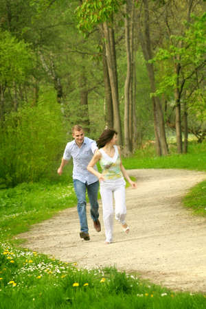 a young happy and smiling couple is playing tag Stock Photo - 5076029