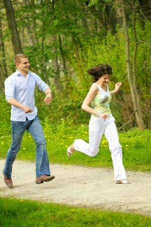 a young happy and smiling couple is playing tag Stock Photo - 5075991