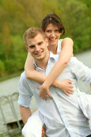a happy couple is playing on a lake Stock Photo - 5075989