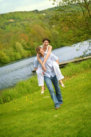 a happy couple is playing on a lake Stock Photo - 5075477