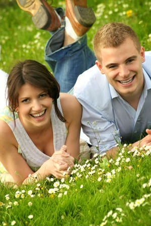 a happy couple on a green meadow is smiling Stock Photo - 5075987