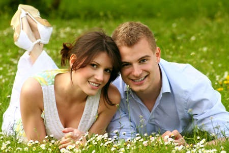 a happy couple on a green meadow is smiling Stock Photo - 5075992