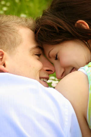 a happy and smiling couple is cuddle on a green meadow Stock Photo - 5075977