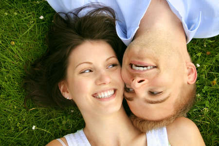 a happy and smiling couple is cuddle on a green meadow Stock Photo - 5075994