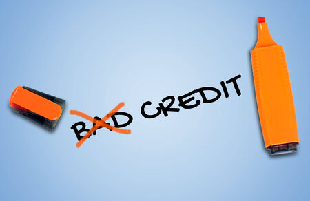 Bad credit word on blue background photo