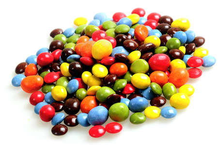 Isolated stack of colorful candies on white background photo