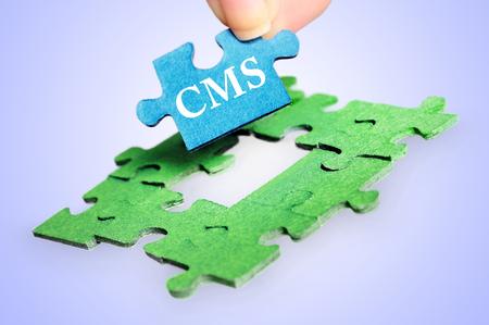 CMS word on blue background photo