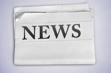 News word on newspaper page photo