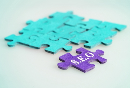 optimizer: Puzzle word Seo on blue background Stock Photo