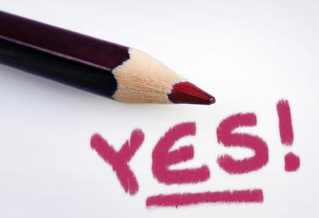 optimist: Yes word on grey background Stock Photo