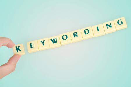 keywording: Keywording word on blue background