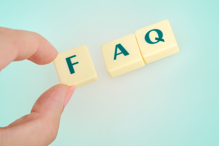 frequent: FAQ word on blue background Stock Photo