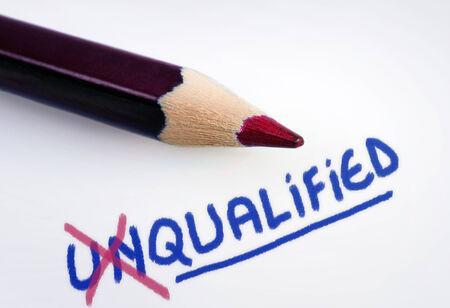 qualify: Unqualified word on grey background
