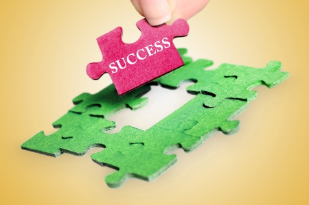 Puzzle with Success word piece photo