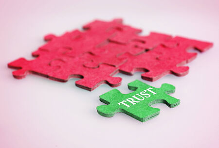 Puzzle with Trust word piece photo