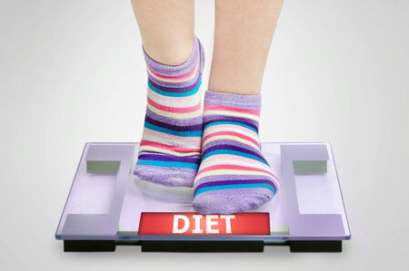 Diet word on grey scales photo